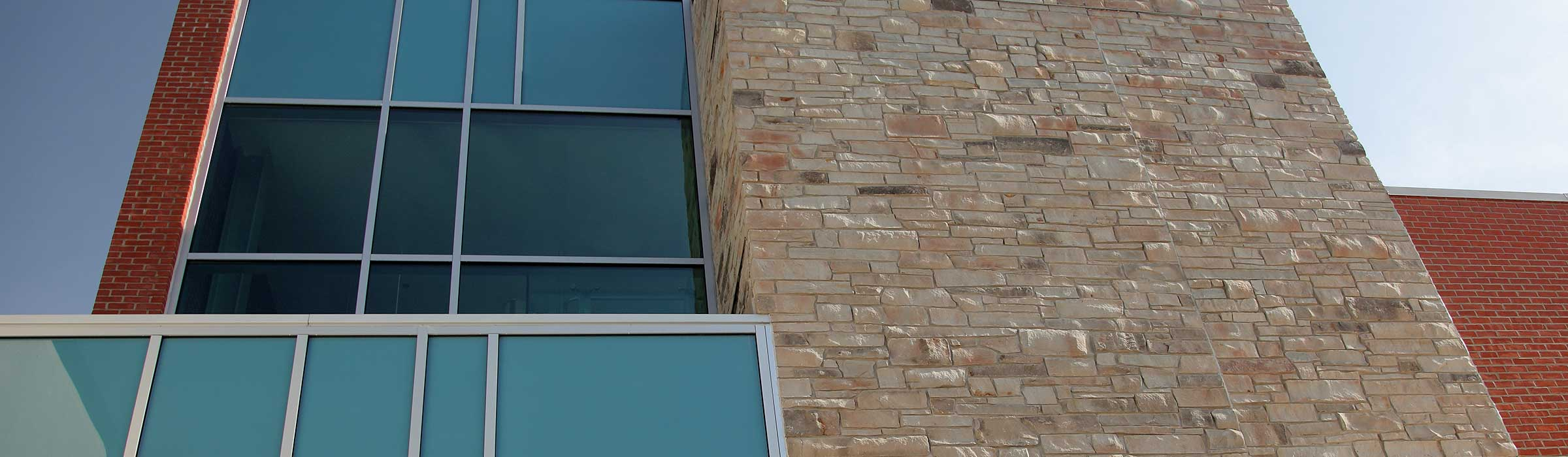 Credit Valley sandstone, paired with glass and brick